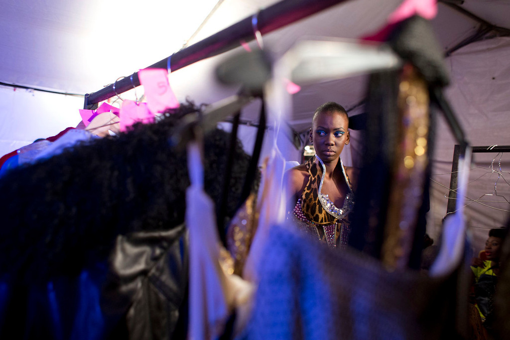 . A model dresses in a design by Habib Sangare of Ivory Coast, backstage at Hotel des Almadies, in Dakar, Senegal, on Saturday, June 22, 2013. After a Friday show held in a dusty marketplace in the working class suburb of Guediawaye, the runway finale of Dakar Fashion Week was held at a luxury hotel and showcased the work of 14 designers from West Africa, Europe, South America, and the Caribbean. (AP Photo/Rebecca Blackwell)