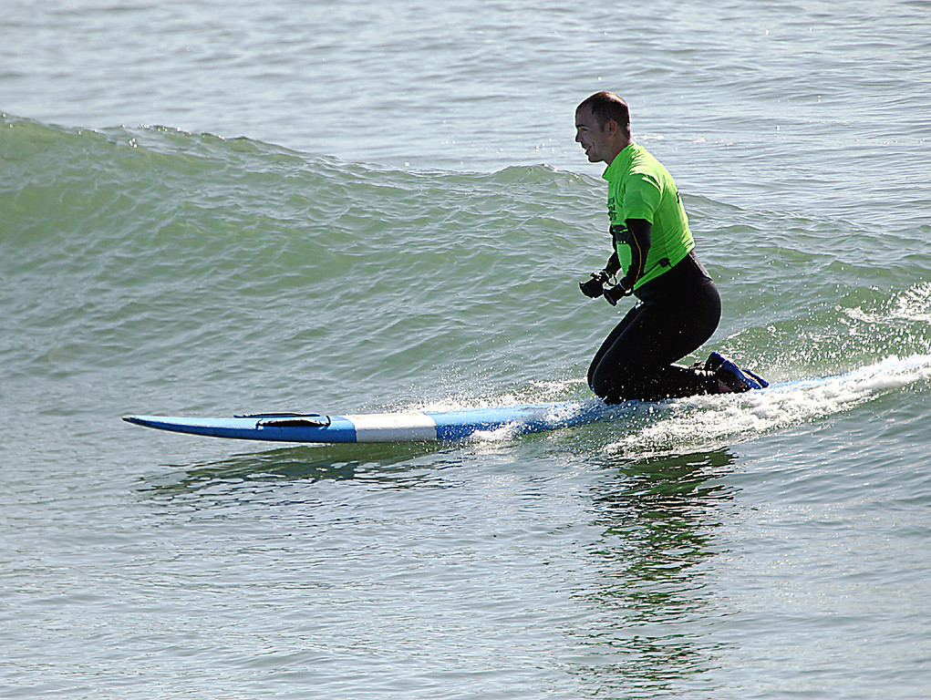 . Rehabbing soldier Eric Lund grins from ear to ear as he takes this wave all the way to Cowell Beach in Santa Cruz, Calif., Tuesday, April 16, 2013, as local surfers coached war-wounded vets through Operation Surf.  (Dan Coyro/Sentinel)