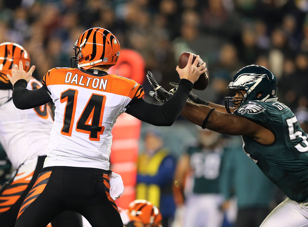 . Brandon Graham #54 of the Philadelphia Eagles knocks the ball from  Andy Dalton #14 of the Cincinnati Bengals on December 13, 2012 at Lincoln Financial Field in Philadelphia, Pennsylvania.  (Photo by Elsa/Getty Images)