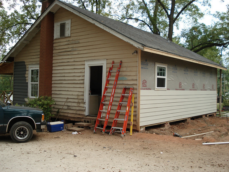 Hardy board goes up on back of house. ck