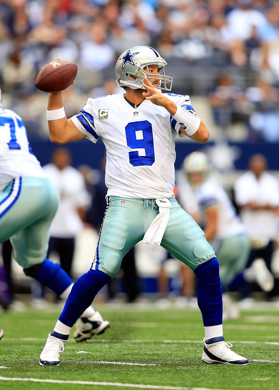 . Quarterback Tony Romo #9 of the Dallas Cowboys passes during the game against the Minnesota Vikings at Cowboys Stadium on November 3, 2013 in Arlington, Texas.  (Photo by Jamie Squire/Getty Images)