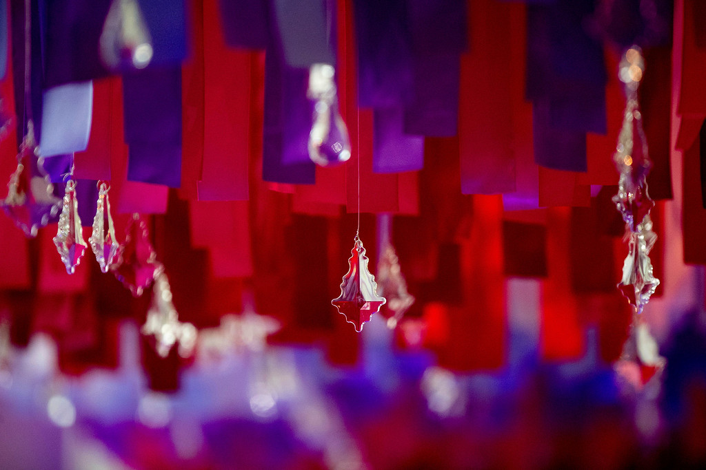 . More than 7,500 strands of colored ribbon hang with with sparkling crystal ornaments on the East Colonnade of the White House during a preview of the 2016 holiday decor, Tuesday, Nov. 29, 2016, in Washington. (AP Photo/Andrew Harnik)
