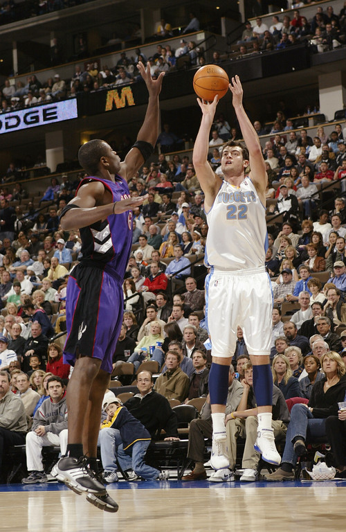 . 2002: Nikoloz Tskitishvili (No. 5) Nikoloz Tskitishvili #22 of the Denver Nuggets shoots over Jerome Moiso #6 of the Toronto Raptors during the game at Pepsi Center on November 17, 2004 in Denver, Colorado.  The Nuggets won 112-106.(Photo by Brian Bahr/Getty Images)