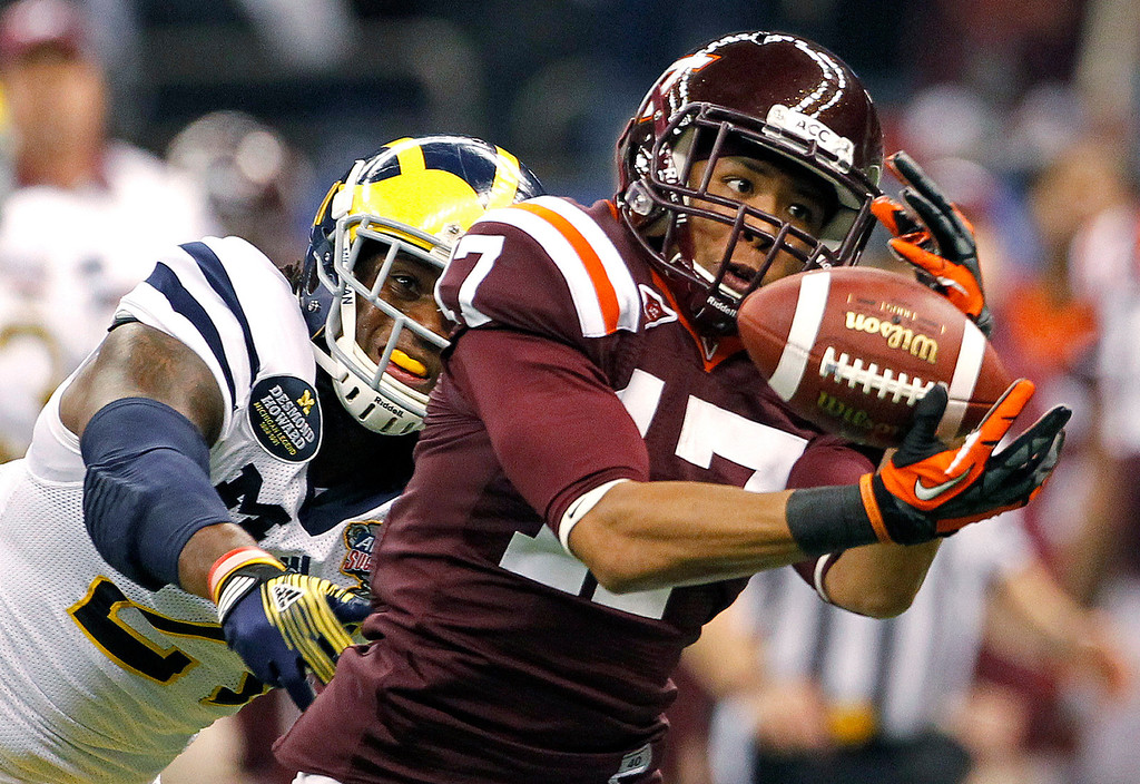 . 1. CB Kyle Fuller, Virginia Tech, 6-0, 190: Not a burner, but compensates with smart play. Already considered NFL ready because of his ability to play press coverage and tackle in the open field. Broncos would have to trade up to have a shot at him, possibly surrendering second and third-round picks next year.  (AP Photo/Dave Martin)