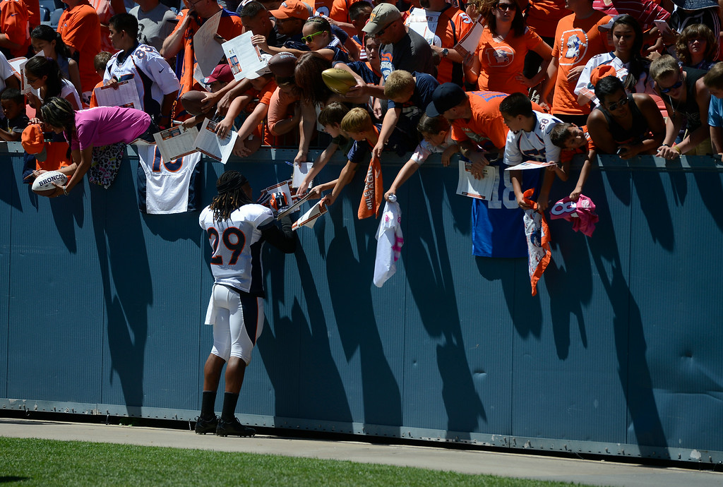 . Denver Broncos CB, Bradley Roby, signs autographs for fans  after autographing it for a fan  after practice and scrimmage at Sports Authority Field at Mile High Saturday afternoon, August 02, 2014. (Photo By Andy Cross / The Denver Post)