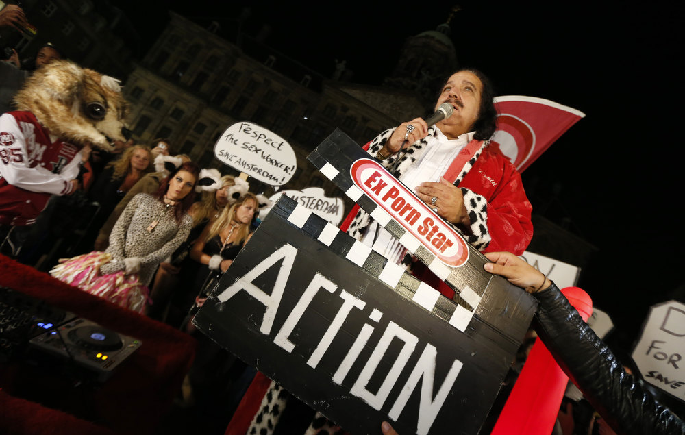 Description of . US adult film actor Ron Jeremy speaks at a demonstration in Amsterdam in support of legal sex workers on September 30, 2012. Jeremy is in the Netherlands to demonstrate against the Amsterdam municipality's moves to reduce the number of brothels in the city's famed Red Light District in an effort to cut the crime rate. JERRY LAMPEN/AFP/GettyImages