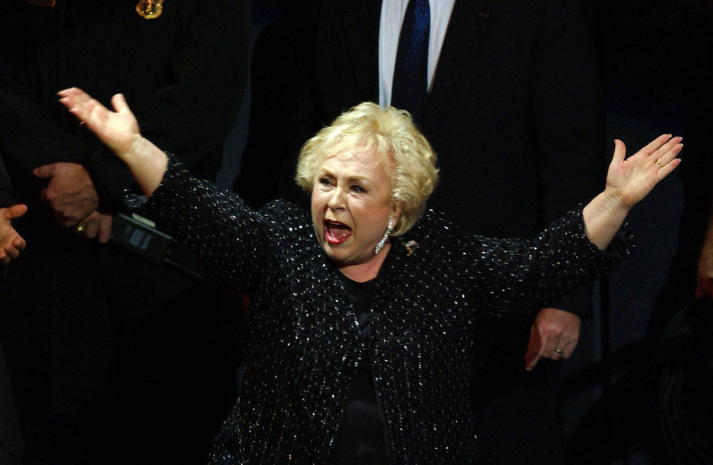 """. Actress Doris Roberts reacts as she is awarded for Best Supporting Actress in a Comedy Series for her role in \""""Everybody Loves Raymond\"""" during the 53rd Emmy Awards show in Los Angeles, CA, 04 November, 2001.  After two postponements attributed to the war on terrorism the awards show is finally being held at a small venue the Shubert Theatre.  LUCY NICHOLSON/AFP/Getty Images"""