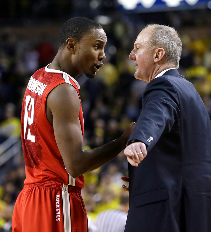 . Ohio State forward Sam Thompson talks with head coach Thad Matta during the second half of an NCAA college basketball game against Michigan, Sunday, Feb. 22, 2015 in Ann Arbor, Mich. Michigan defeated Ohio State 64-57. (AP Photo/Carlos Osorio)