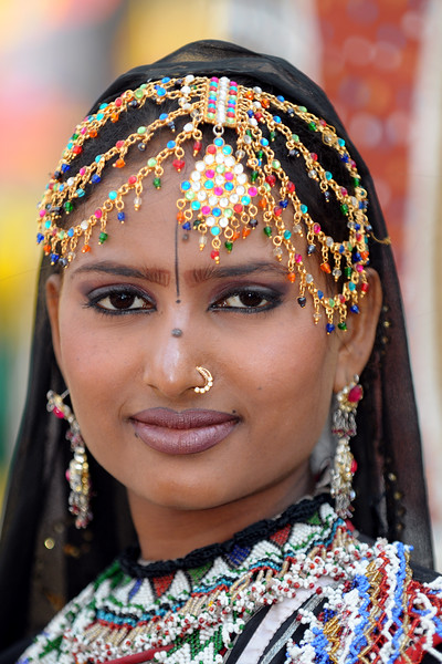 Lady artist Radha Sapera, from the Rajki-Puran Nath Sapera & Party, Jaipur photographed at the Suraj Kund Mela 2009 held in Haryana (outskirts of Delhi), North India. The Suraj Kund Mela is an annual fair held near Delhi. Folk dances, handicrafts and a lot of fun.