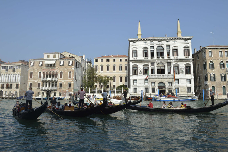 """. Tourists sat on gondolas taking pictures of the Aman hotel on September 28, 2014 on the Grand Canal in Venice where US actor George Clooney and British fiancee, Amal Alamuddin celebrate their wedding. Hollywood heartthrob George Clooney and Lebanese-British lawyer Amal Alamuddin married in Venice on Saturday September 27, 2014 before partying the night away with their A-list friends in one of the most high-profile celebrity weddings in years. \""""George Clooney and Amal Alamuddin were married today (September 27) in a private ceremony in Venice, Italy,\"""" Clooney spokesman Stan Rosenfield said. The announcement came as a surprise as the pair were not expected to officially tie the knot until Monday, though they are still tipped for a civil ceremony at the town hall to make the marriage official under Italian law. ANDREAS SOLARO/AFP/Getty Images"""