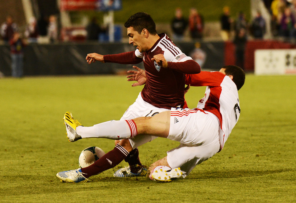 . COMMERCE CITY, CO. - MAY 04 : Martin Rivero #10 of Colorado Rapids is fouled by Logan Emory #2 of Toronto FC in the 2nd half of the game at Dick\'s Sporting Goods Park in Commerce City, Colorado. May 4, 2013. Colorado won 1-0. (Photo By Hyoung Chang/The Denver Post)