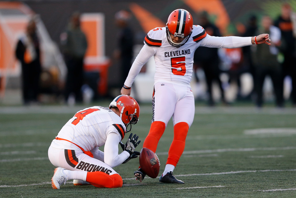 . Cleveland Browns kicker Zane Gonzalez (5) kicks a field goal alongside punter Britton Colquitt (4) in the second half of an NFL football game against the Cincinnati Bengals, Sunday, Nov. 26, 2017, in Cincinnati. (AP Photo/Gary Landers)