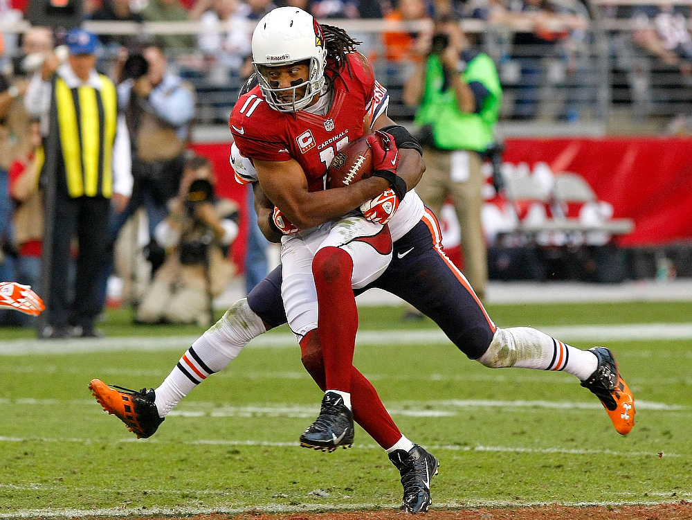 . Arizona Cardinals wide receiver Larry Fitzgerald (11) pulls in a pass against the Chicago Bears during the second half of an NFL football game, Sunday, Dec. 23, 2012, in Glendale, Ariz. (AP Photo/Rick Scuteri)