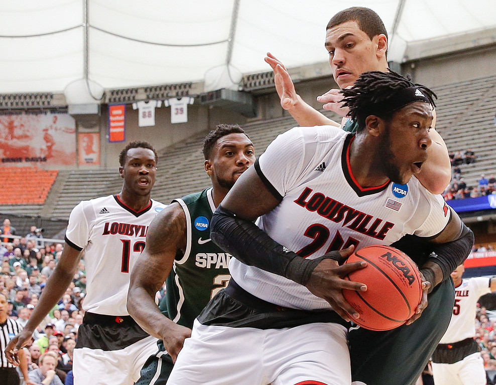 . Louisville\'s Montrezl Harrell (24) fights for position against Michigan State\'s Gavin Schilling during the first half of a regional final in the NCAA men\'s college basketball tournament Sunday, March 29, 2015, in Syracuse, N.Y. (AP Photo/Seth Wenig)