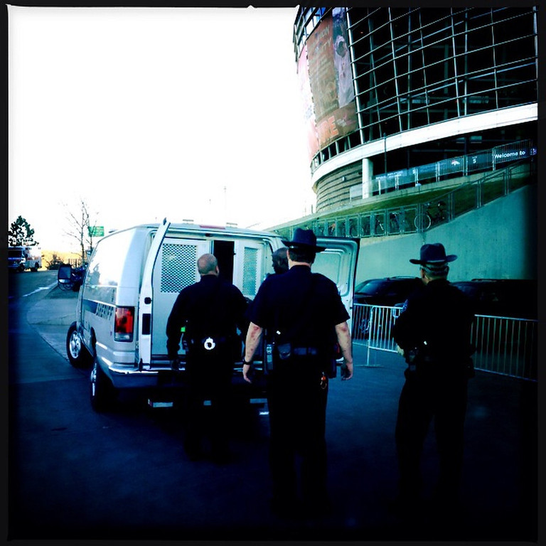 . A Patriots fan is arrested outside the stadium. Photo by Tim Rasmussen.
