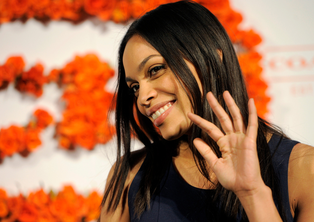 . Actress Rosario Dawson waves to photographers at the 3rd Annual Coach Evening to Benefit Children\'s Defense Fun at Bad Robot on Wednesday, April 10, 2013 in Santa Monica, Calif. (Photo by Chris Pizzello/Invision/AP)