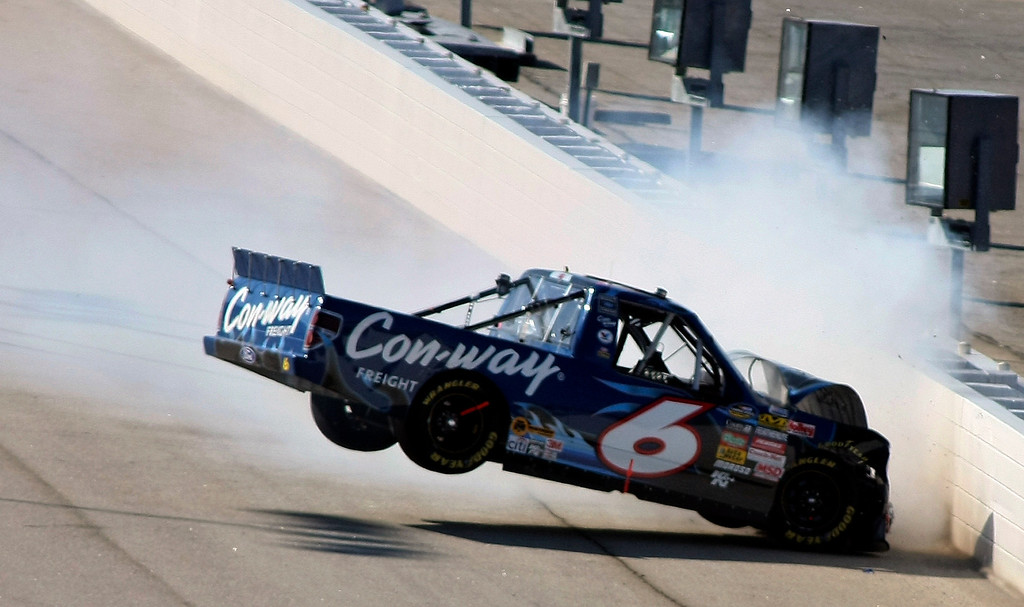 . Driver Colin Braun crashes during the American Commercial Lines 200 NASCAR Camping World Truck Series auto race at Atlanta Motor Speedway in Hampton, Ga., Saturday, March 7, 2009. (AP Photo/Greg McWilliams)