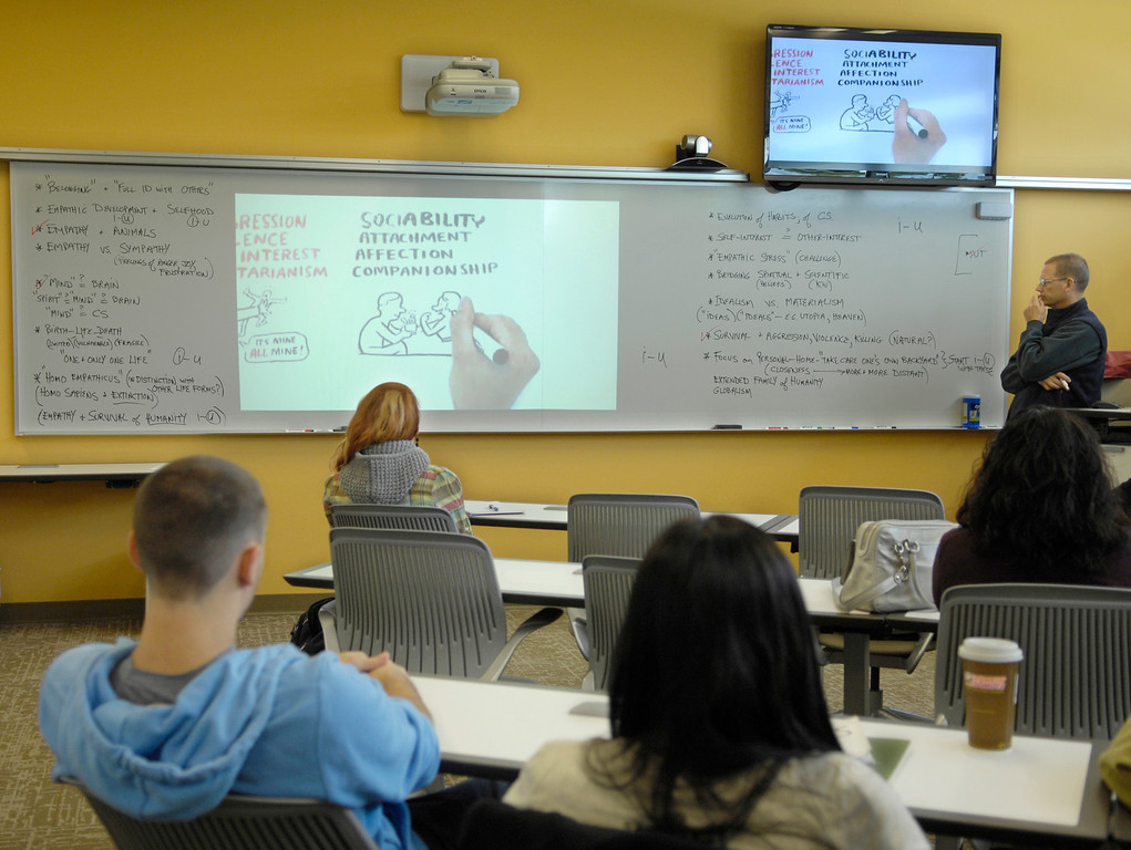. Students take part in an Ethics class taught by adjunct professor Edmund Capkevicius at Lakeland\'s Holden Center in September 2012. Technology is one of the big changes in teaching since Lakeland Community College opened.  (News-Herald file)