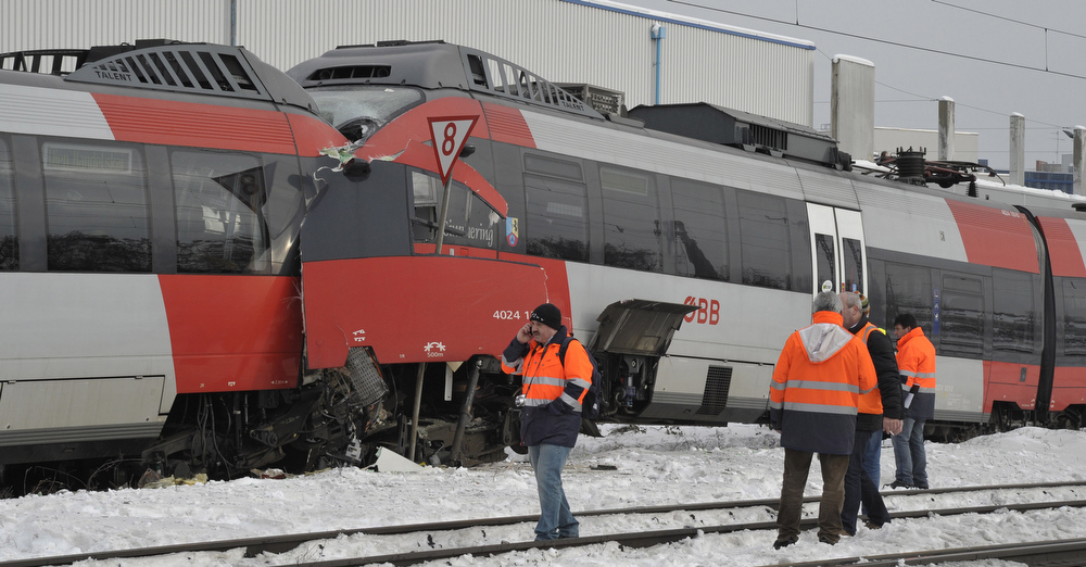 Description of . The driver\'s cabins are seen destroyed after two regional trains crashed head on in Vienna, Austria, Monday, Jan. 21, 2013. Several  people were injured. (AP Photo/dapd, Hans Punz)