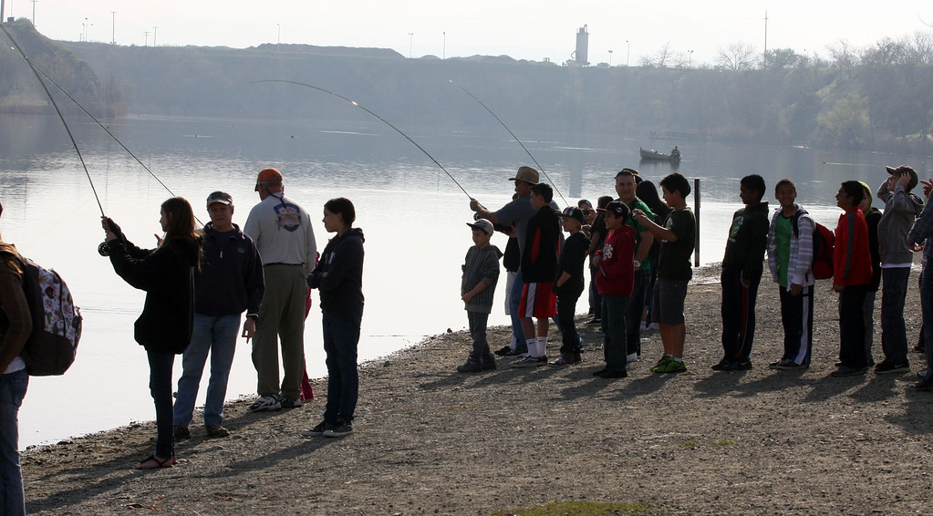 . Students get fly fishing lessons from members of the Tracy Fly Fishers club at the Trout in the Classroom program, sponsored by the State Department of Fish and Wildlife, at Shadow Cliffs Regional Recreation Area in Pleasanton, Calif., on Thursday, March 14, 2013. Classes are given 35 trout eggs and tanks. When the hatchlings are large enough they are released into local lakes.