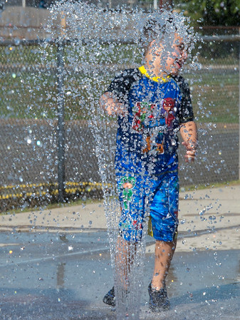 08/20/19 Wesley Bunnell | Staff Julian Mireles, age 4, runs through a water fountain at the splash pad at Chesley Park on Tuesday August 20, 2019.