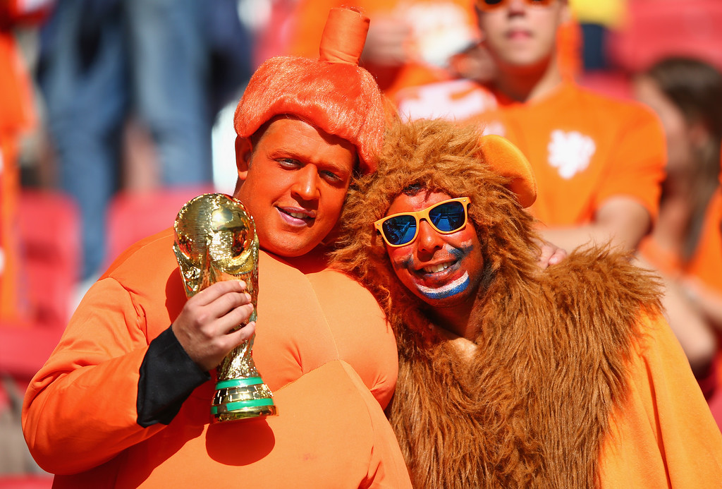 . A fan of the Netherlands holds a replica of the World Cup trophy prior to the 2014 FIFA World Cup Brazil Group B match between Australia and Netherlands at Estadio Beira-Rio on June 18, 2014 in Porto Alegre, Brazil.  (Photo by Ian Walton/Getty Images)