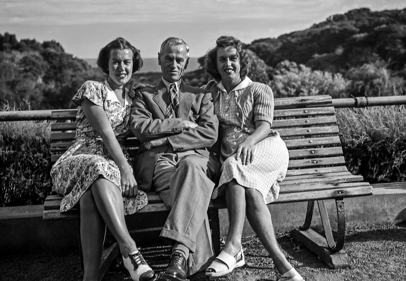 Man Flanked By Two Women at Cave House.jpg
