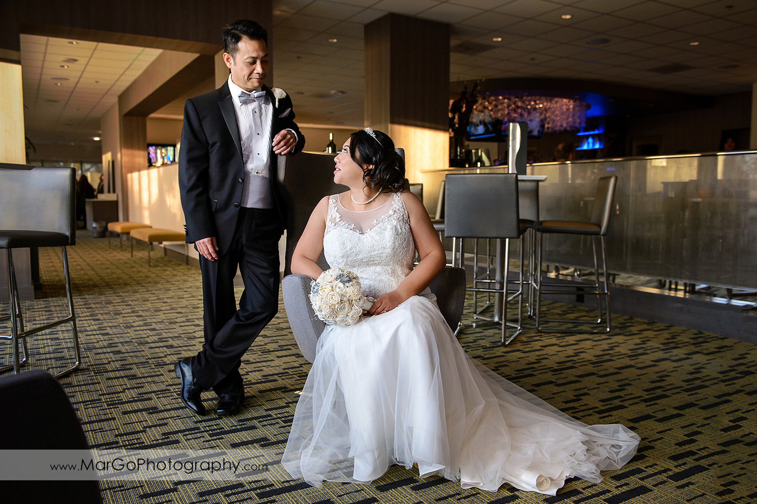 bride and groom in the lobby of Hilton San Francisco Airport Bayfront in Burlingame