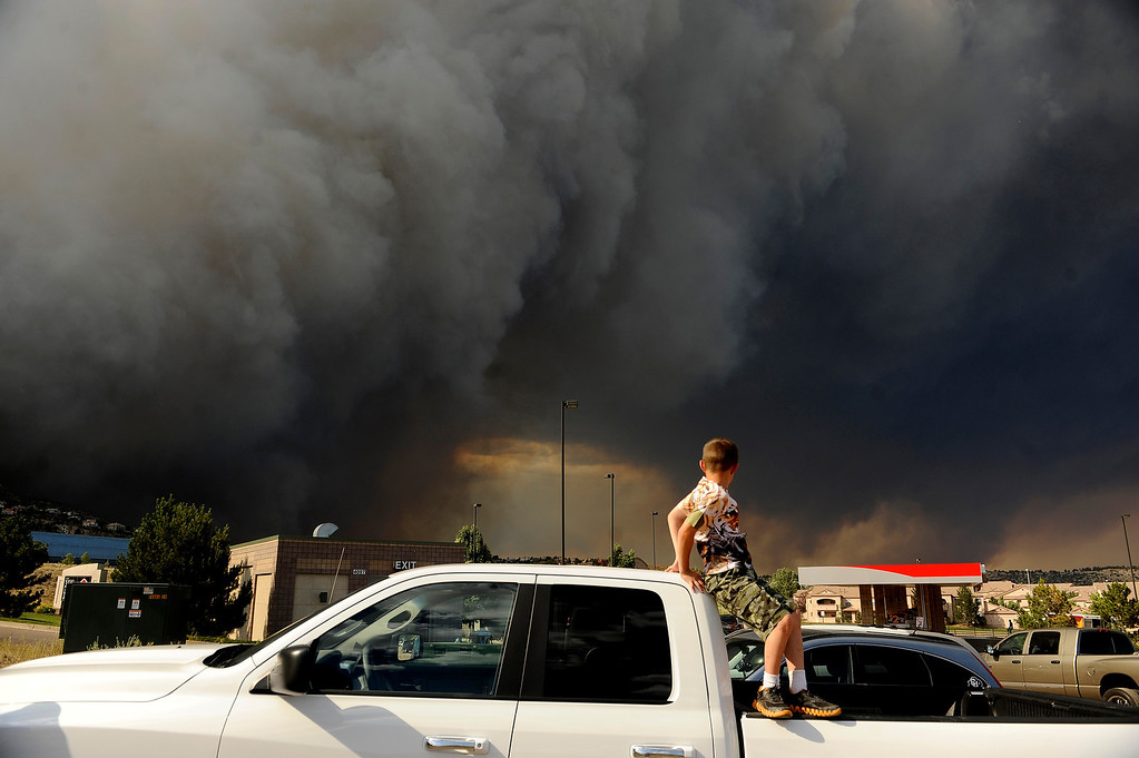 . Caden Manes, 8, watches as the Waldo Canyon fire explodes on June 26th, 2012. Helen H. Richardson, The Denver Post