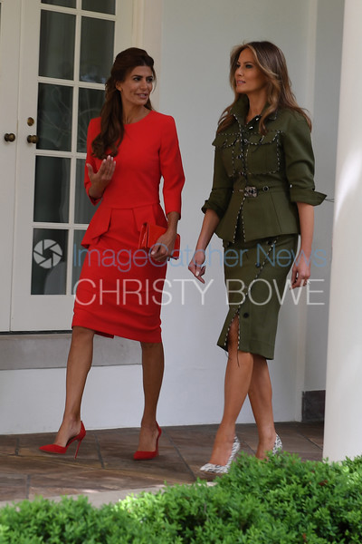 First Lady Melania Trump and First Lady Juliana Awada of Argentina walk along the Colonnade to the Oval Office.