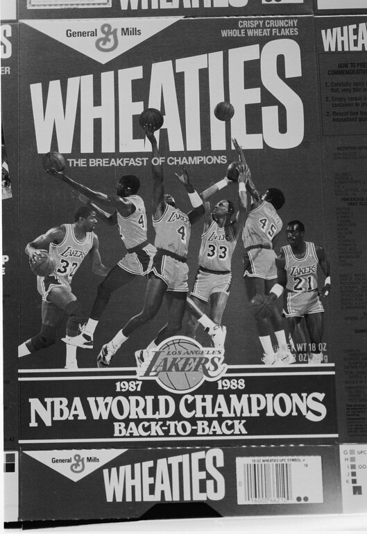 . The Los Angeles Lakers, from left, Magic Johnson, James Worthy, Byron Scott, Kareem Abdul-Jabbar, A.C. Green and Michael Cooper, adorn the latest General Mills Wheaties cereal box, 1 million of which will be distributed in California in honor of the Lakers recent recovery of the NBA world title, June 24, 1988. (AP Photo/Ira Mark Gostin)