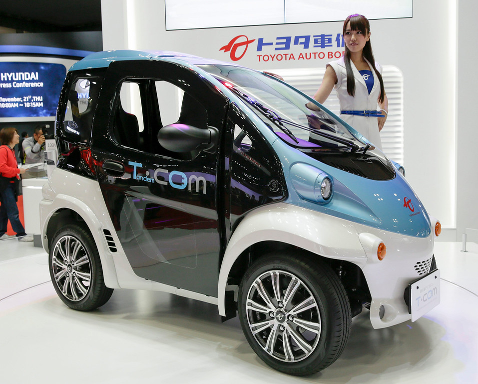. Toyota Auto Body unveils its super compact electric vehicle COMS at the 43rd Tokyo Motor Show 2013 in Tokyo, Japan, 20 November 2013. EPA/KIMIMASA MAYAMA