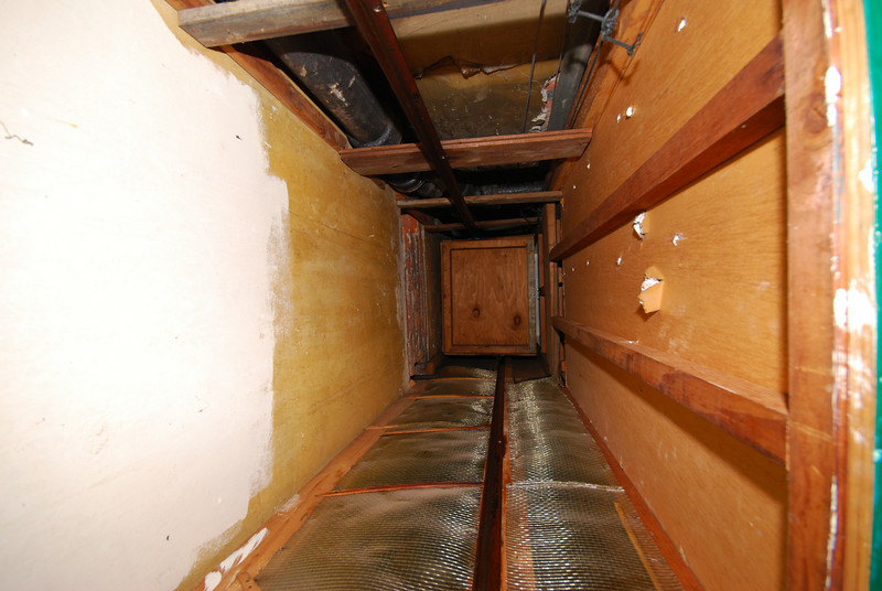Looking up the dumbwaiter shaft. You can see the underside of the carriage at the second floor. There are ropes along the sides (visible at the top of the frame), but we didn't pull on them.