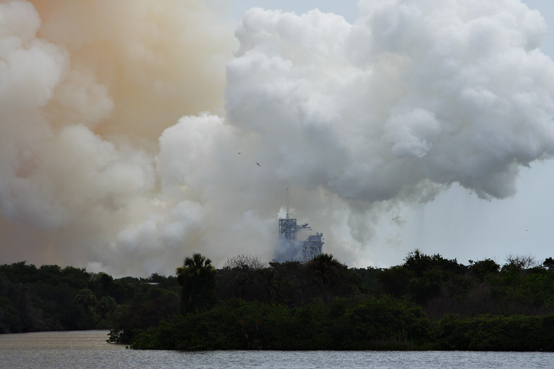 The launch plume looms over Pad 39A.