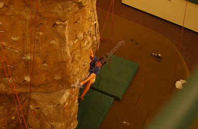 22856 Students on climbing wall for billboard ad