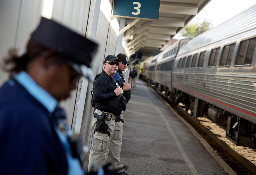 . Department of Homeland Security officials stand along a platform as a train to New Orleans arrives in Atlanta, Wednesday, Nov. 23, 2016. Almost 49 million people are expected to travel 50 miles or more for the Thanksgiving holiday, the most since 2007, according to AAA. (AP Photo/David Goldman)
