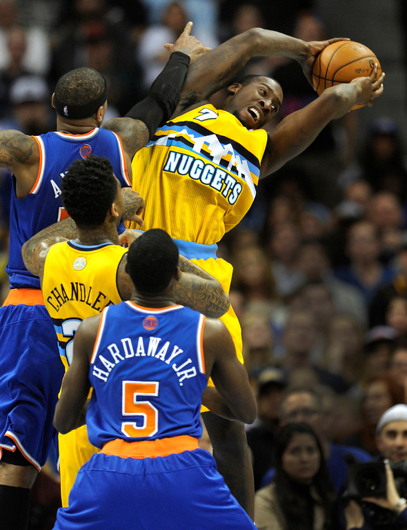 . DENVER, CO. - NOVEMBER 29: Denver forward J.J. Hickson secured a rebound in the second half. The Denver Nuggets defeated the New York Knicks 97-95 at the Pepsi Center Friday night, November 29, 2013. Photo By Karl Gehring/The Denver Post