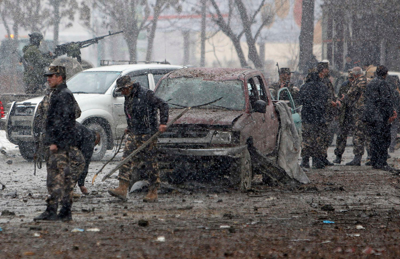 . Afghan security forces investigate at the site of a car bomb attack in Kabul January 16, 2013. Six suicide bombers launched a coordinated attack on Afghanistan\'s spy agency in Kabul on Wednesday, killing at least two and wounding 22 others, Afghan officials said.  REUTERS/Mohammad Ismail