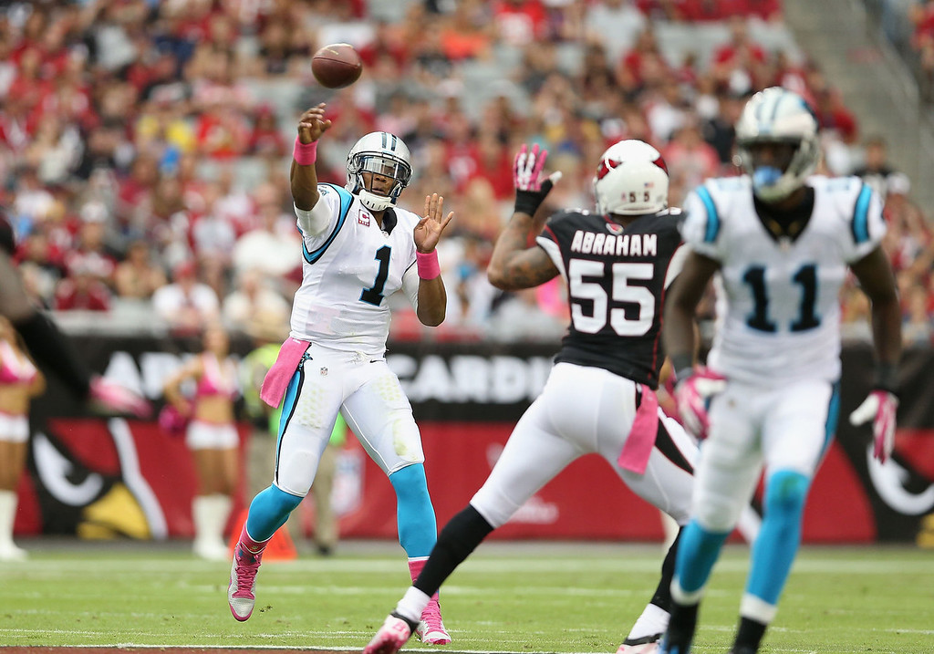 . Quarterback Cam Newton #1 of the Carolina Panthers throws a pass during the first quarter of the NFL game against the Arizona Cardinals at the University of Phoenix Stadium on October 6, 2013 in Glendale, Arizona.  (Photo by Christian Petersen/Getty Images)
