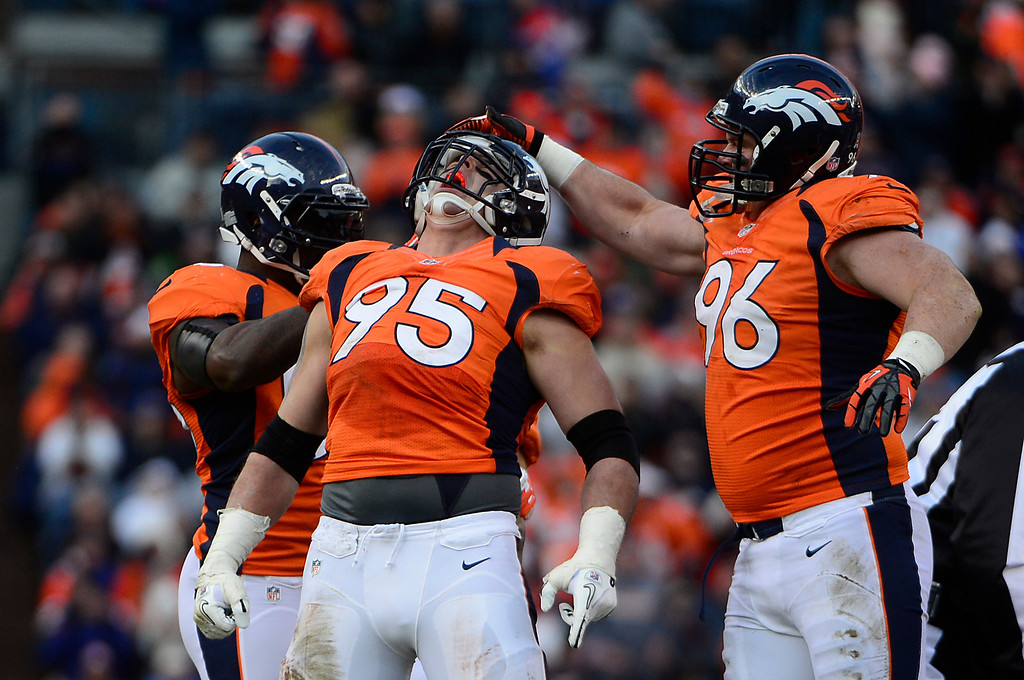 . Denver Broncos defensive end Derek Wolfe (95) and Denver Broncos defensive tackle Mitch Unrein (96) celebrates a sack in the second quarter as the Denver Broncos took on the Kansas City Chiefs at Sports Authority Field at Mile High in Denver, Colorado on December 30, 2012. AAron Ontiveroz, The Denver Post