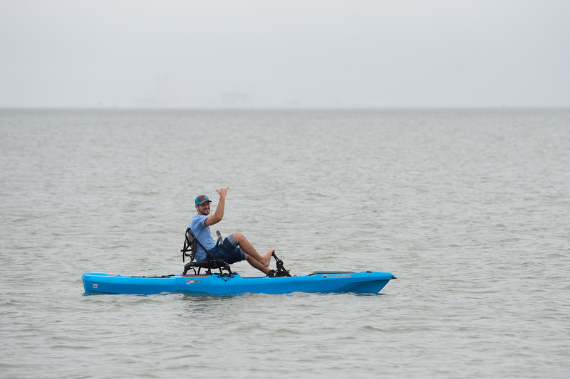 Austin Clark tests out his modified kayak during a test run for Team Propulsion's capstone project on the TAMU-CC beach.