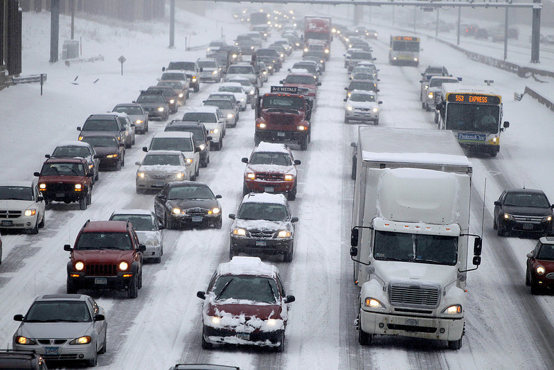 . Traffic makes its way northbound on I-35W into downtown Minneapolis early Tuesday, March 5, 2013. The National Weather Service predicted a two-day snow total of 8 to 12 inches for much of southeastern and east-central Minnesota, including the Twin Cities. (AP Photo/The Star Tribune, Elizabeth Flores)