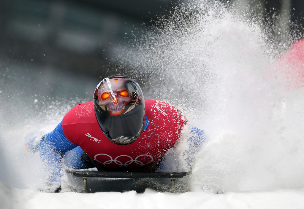 . Joseph Luke Cecchini of Italy brakes in the finish area during the men\'s skeleton training at the 2018 Winter Olympics in Pyeongchang, South Korea, Wednesday, Feb. 14, 2018. (AP Photo/Michael Sohn)
