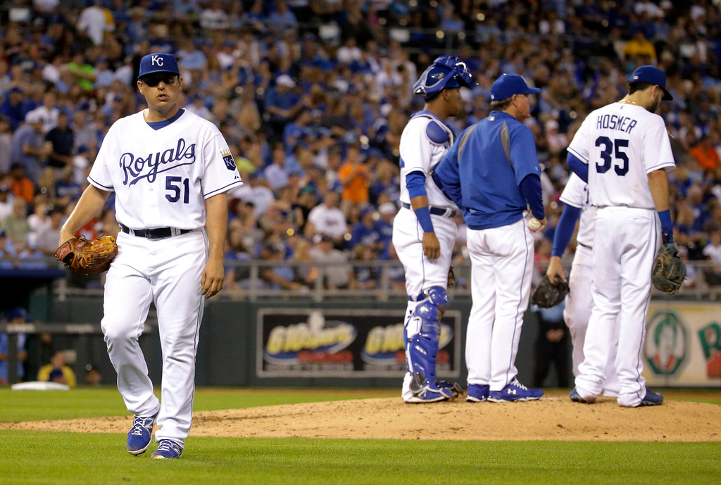 . Kansas City Royals starting pitcher Jason Vargas (51) walks to the dugout after a pitching change during the fourth inning of a baseball game against the Detroit Tigers on Friday, Sept. 19, 2014, in Kansas City, Mo. (AP Photo/Charlie Riedel)