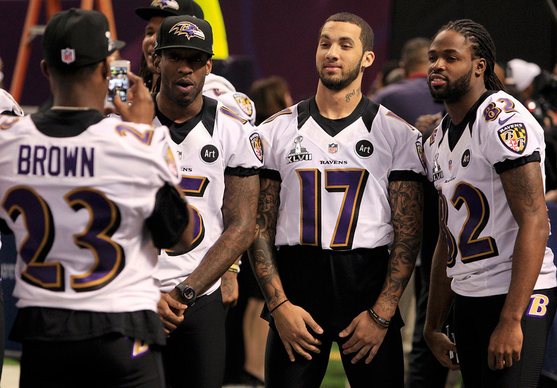 . Baltimore Ravens defensive back Chykie Brown (23) takes a picture of his teammates, LaQuan Williams (15), Tandon Doss (17) and Torrey Smith (82), during Media Day for the NFL\'s Super Bowl XLVII in New Orleans, Louisiana January 29, 2013. The San Francisco 49ers will meet the Ravens in the game on February 3. REUTERS/Sean Gardner