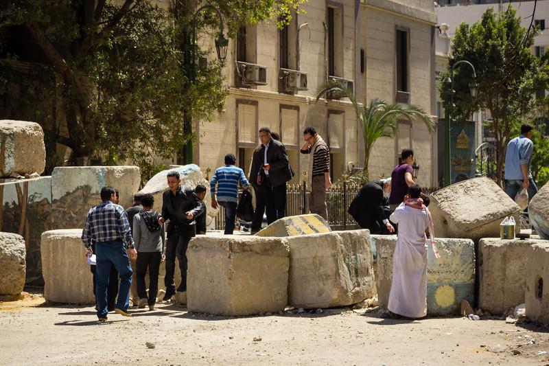 Genevieve Hathaway_Egypt_Arab Spring_daily life_climbing over blocks.jpg
