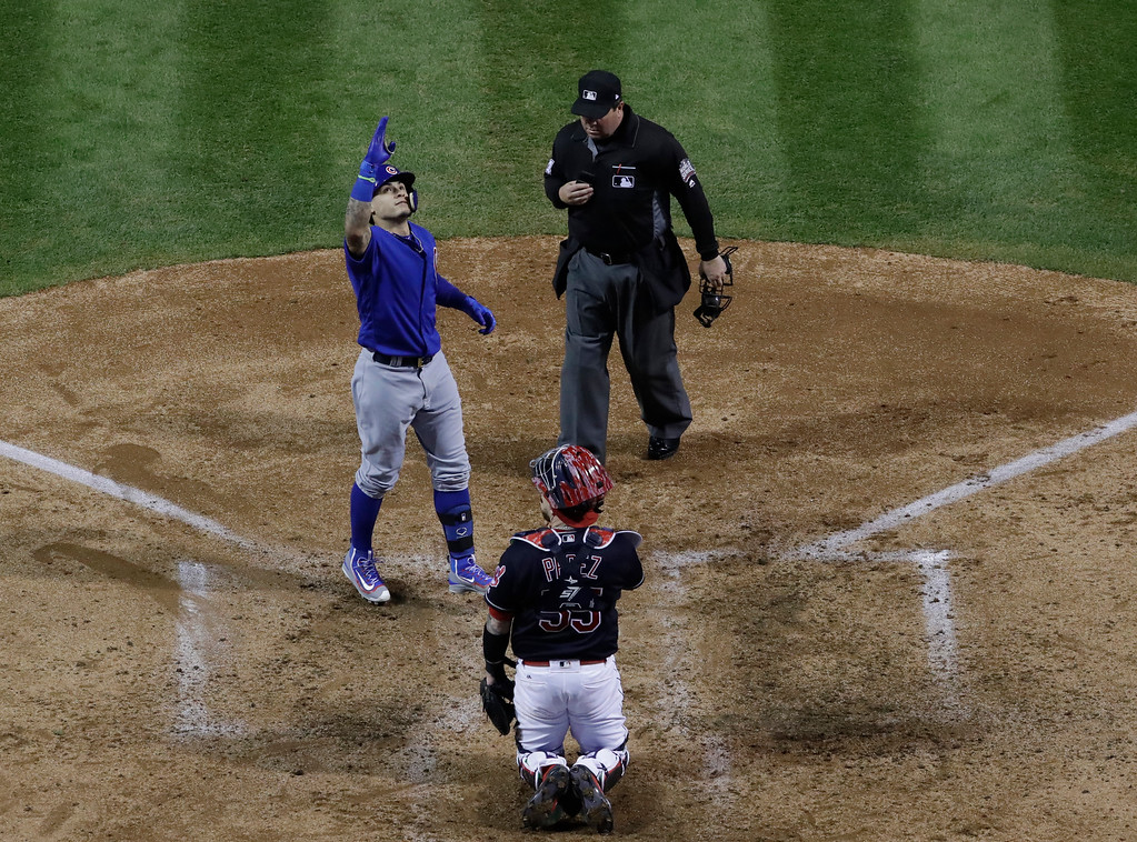 . Chicago Cubs\' Javier Baez celebrates his home run during the fifth inning of Game 7 of the Major League Baseball World Series against the Cleveland Indians Wednesday, Nov. 2, 2016, in Cleveland. (AP Photo/David J. Phillip)