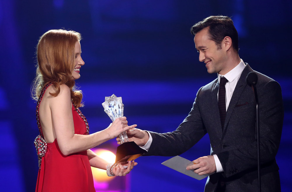 Description of . Joseph Gordon-Levitt, right,  presents the award for best actress to Jessica Chastain at the 18th Annual Critics' Choice Movie Awards at the Barker Hangar on Thursday, Jan. 10, 2013, in Santa Monica, Calif.  (Photo by Matt Sayles/Invision/AP)