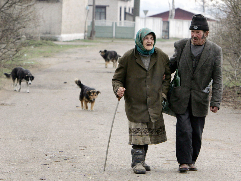 . Two people walk 20 April 2006 in the village of Strelichevo, outside the 30-km exclusion zone around the Chernobyl nuclear reactor, some 360 kms from Minsk. Twenty years after the disaster at the Chernobyl nuclear station, Belarussia is finally aiming at rebuilding the economy in the stricken areas and seeks foreign donors to step up aid, Prime Minister Sergei Sidorsky said. VIKTOR DRACHEV/AFP/Getty Images