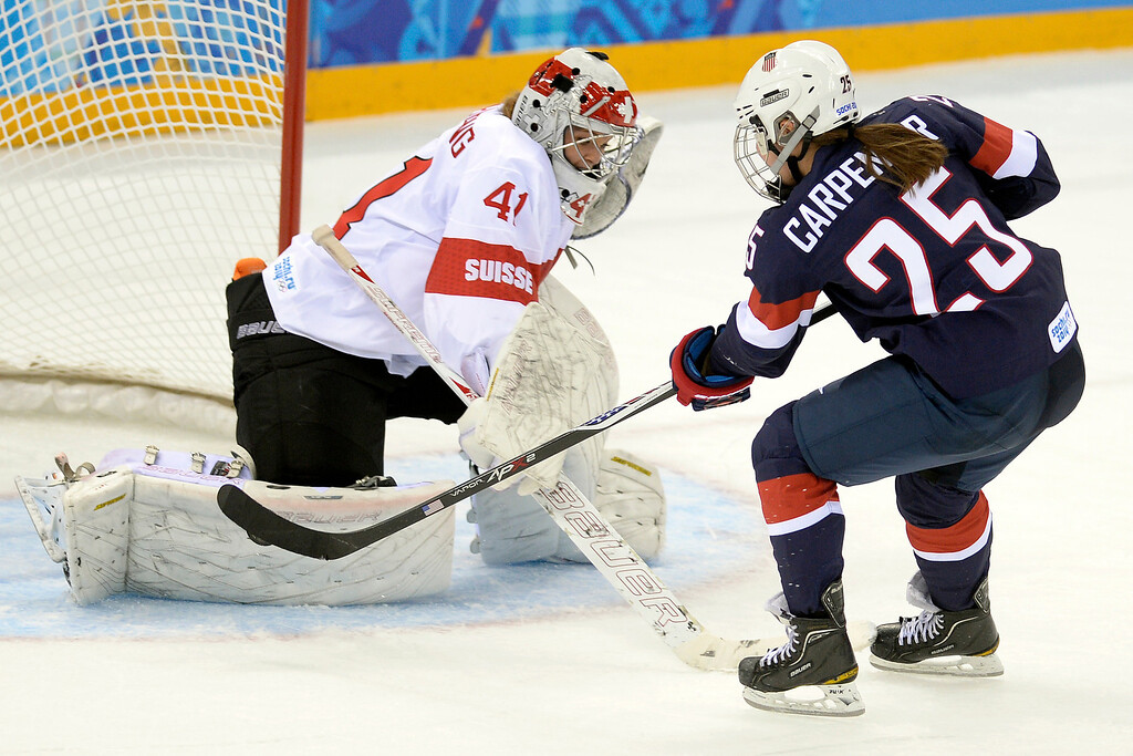 . Alex Carpenter (25) of the U.S.A. scores the ninth goal of the game for her team on Florence Schelling (41) of the Switzerland during the third period of the United States\' 9-0 win at the Shayba Arena. Sochi 2014 Winter Olympics on Monday, February 10, 2014. (Photo by AAron Ontiveroz/The Denver Post)